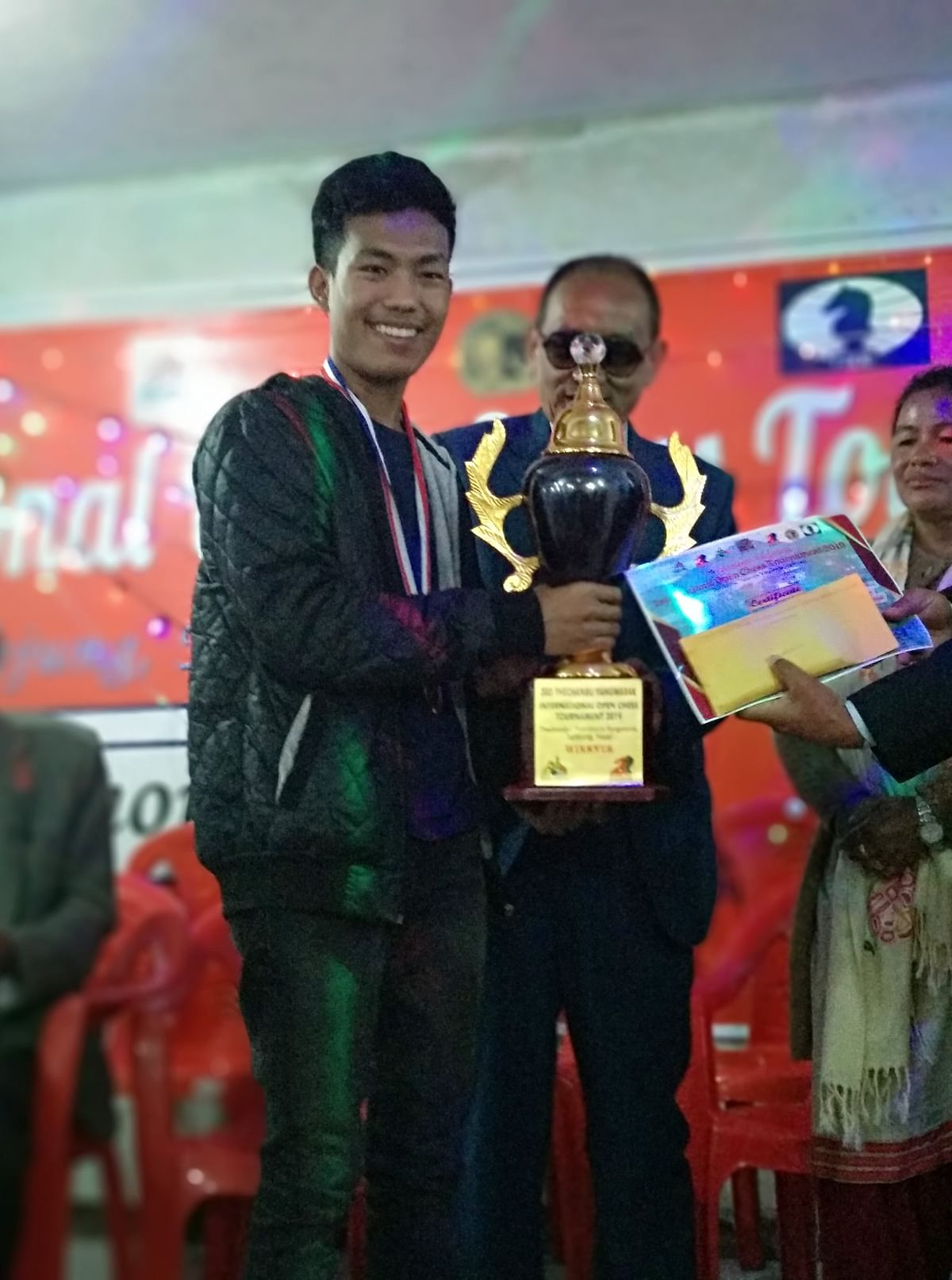 Rahul Gurung accepting the winner's trophy at Taplejung in Nepal