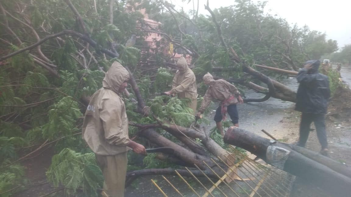 Odisha Police personnel clearing a road
