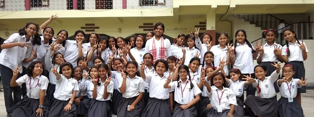 Students of St Mary's School in Guwahati with one of the toppers on Wednesday