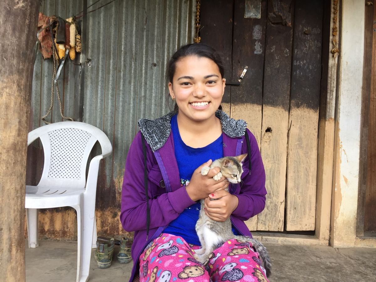 In her free time, Momita Karki loves to play with her cats and dogs