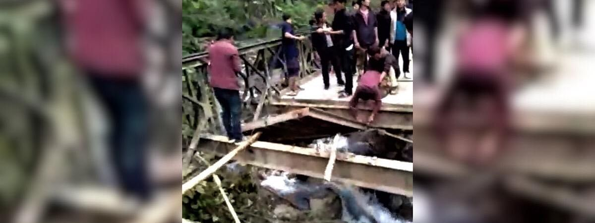 The Bailey bridge being destroyed in Koloriang assembly constituency in Arunachal Pradesh's Kurung Kumey district