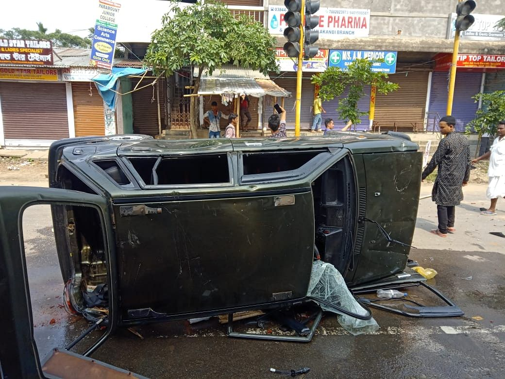 At least 20 vehicles were set ablaze and several shops vandalised in the town