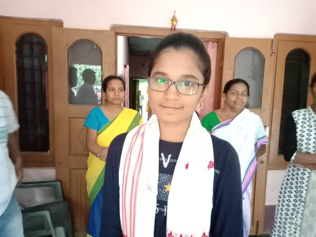 Nishita Khataniar from Bebejia PKS HS School, Nagaon also secured eighth position with 586 marks