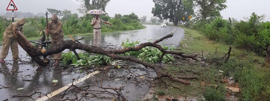 Police personnel clearing a road in Ganjam, Odisha