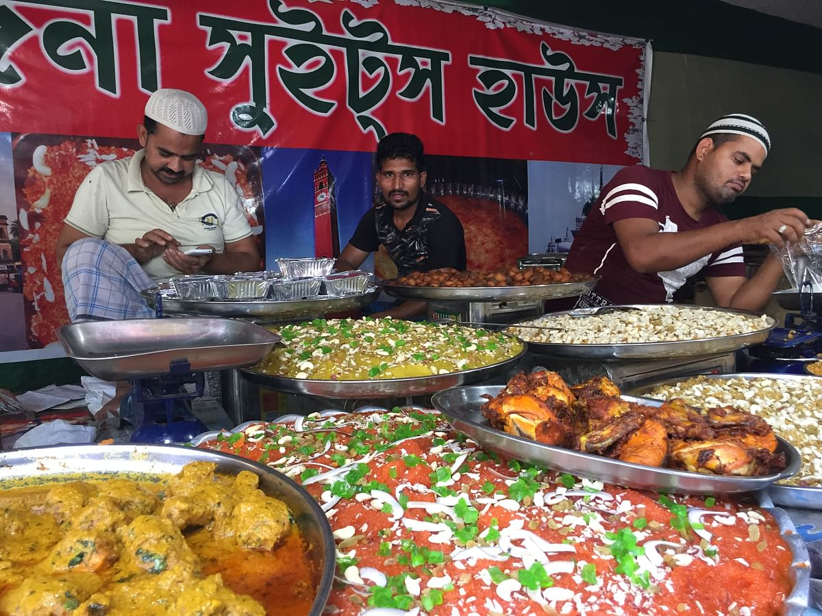 Faithfuls having Iftar offered by the former Indian Army officer at his restaurant in Guwahati, Assam