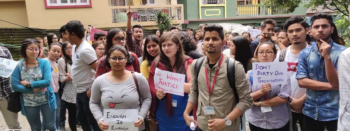 Students protest outside Sikkim University campus against Prof Silajit Guha on Wednesday
