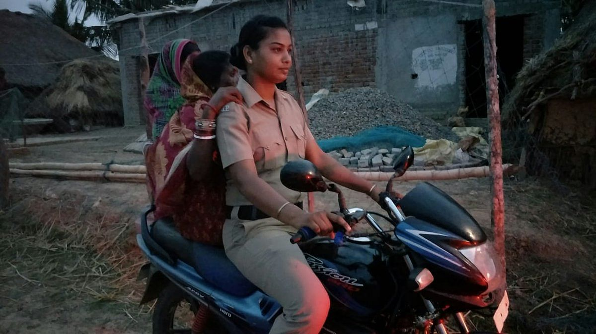 A woman cop of Talchua Police Station in Kendrapara braving all odds to ferry a woman on her motorcycle to safety