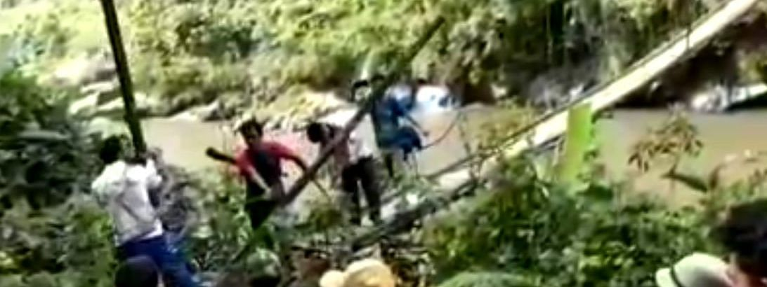 BJP supporters damaging a hanging bridge