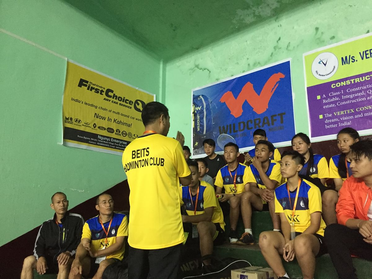 Players attentively listening to the advice shared by the team coach, minutes before the tournament began