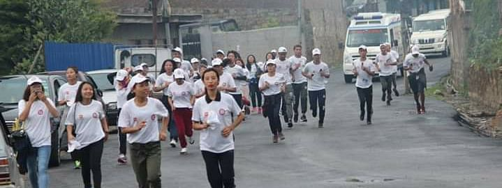 College students taking part in the 'Olympic race' from Old MLA hostel junction to Kohima College in Kohima, Nagaland on Thursday morning