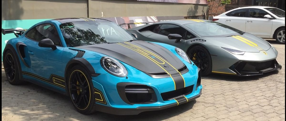 Boopesh Reddy's Porsche 911 GT3 and Lamborghini Huracan parked in Guwahati