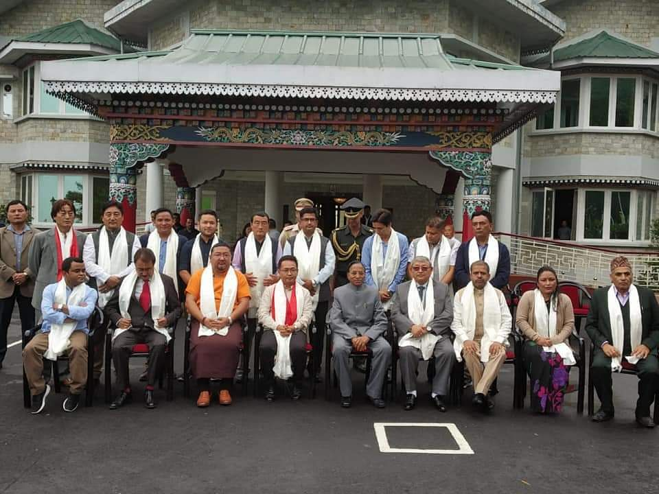 Sikkim Krantikari Morcha president PS Golay with Sikkim governor Ganga Prasad and the 17 winning candidates of the party
