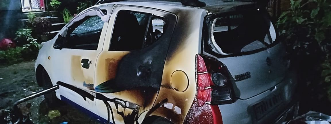 A car that was set on fire by miscreants in Tripura