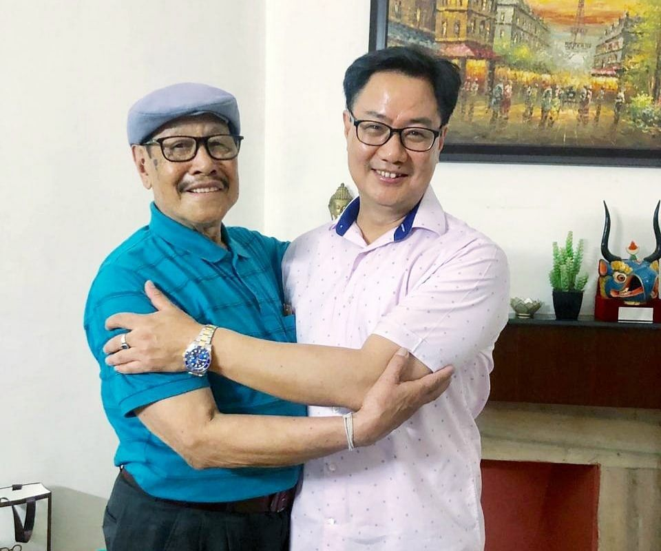 Union minister of state for home Kiren Rijiju (right) with his father Rinchin Kharu