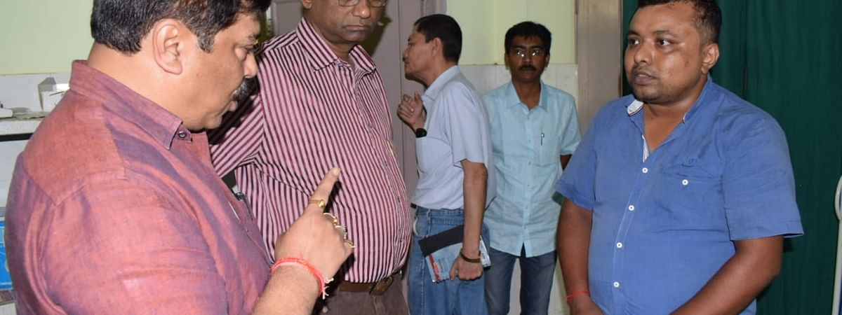 Tripura health minister Sudip Roy Barman (extreme left) after catching Dr Ajoy Biswas (extreme right) red-handed during a surprise visit to a primary health centre in South Tripura district on Wednesday
