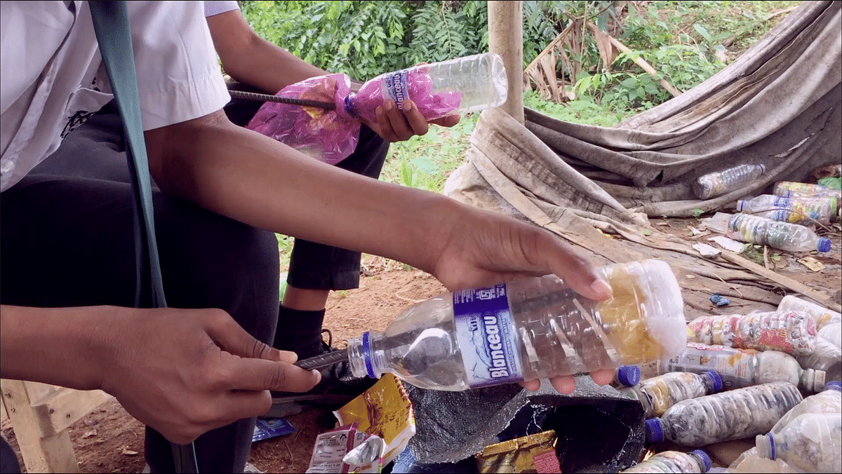 About 20-40 used plastic packets are compressed in a used plastic bottle to make an 'eco-brick'