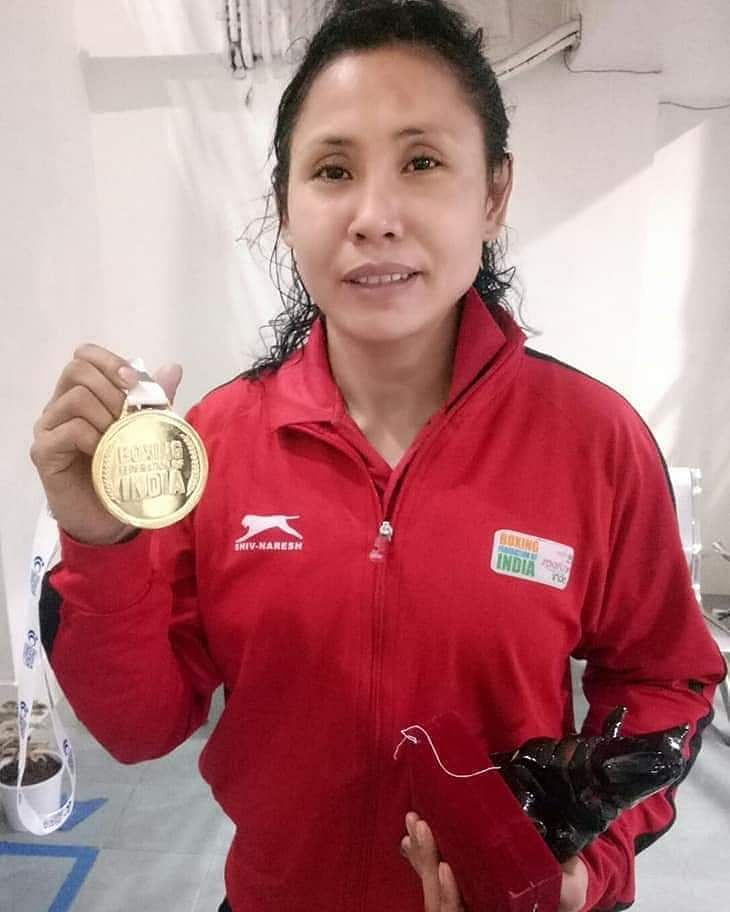 Manipur's L Sarita Devi displays her gold medal after her victory at the India Open International Boxing Tournament in Guwahati on Friday