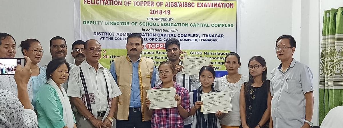 Capital complex DC Vikram Singh Malik with the toppers