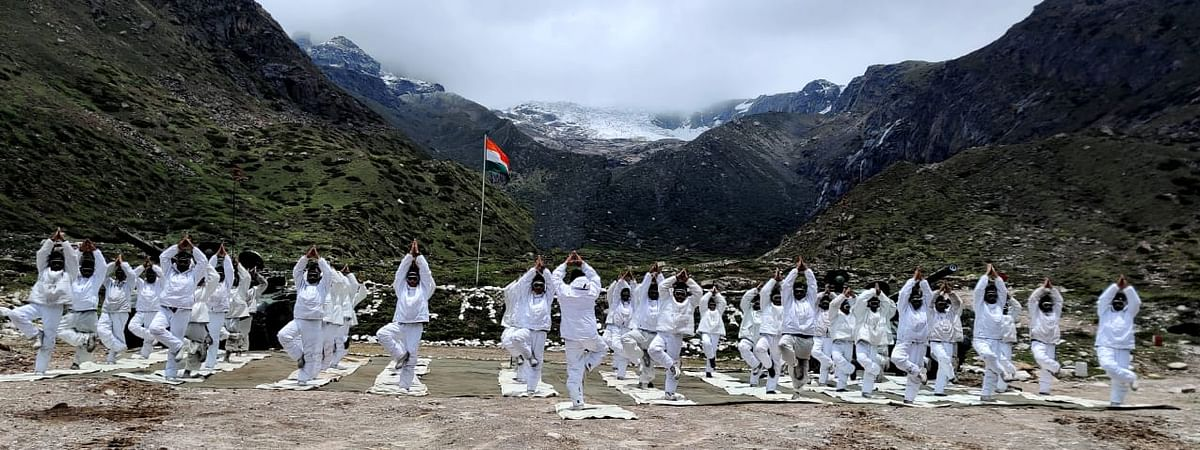 Indian Army personnel practising yoga