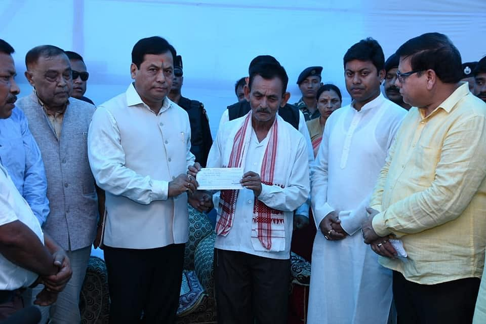 Chief minister Sarbananda Sonowal handing over a cheque of Rs 20 lakh to family members of martyr Niraj Chetry in Halem on Thursday
