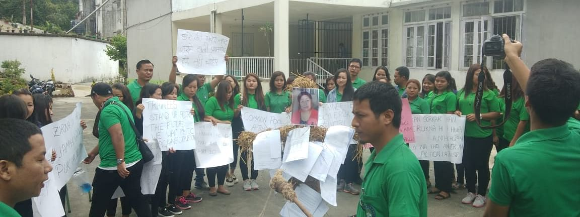 Students of Mizoram Hindi Training College taking out a protest rally on Monday