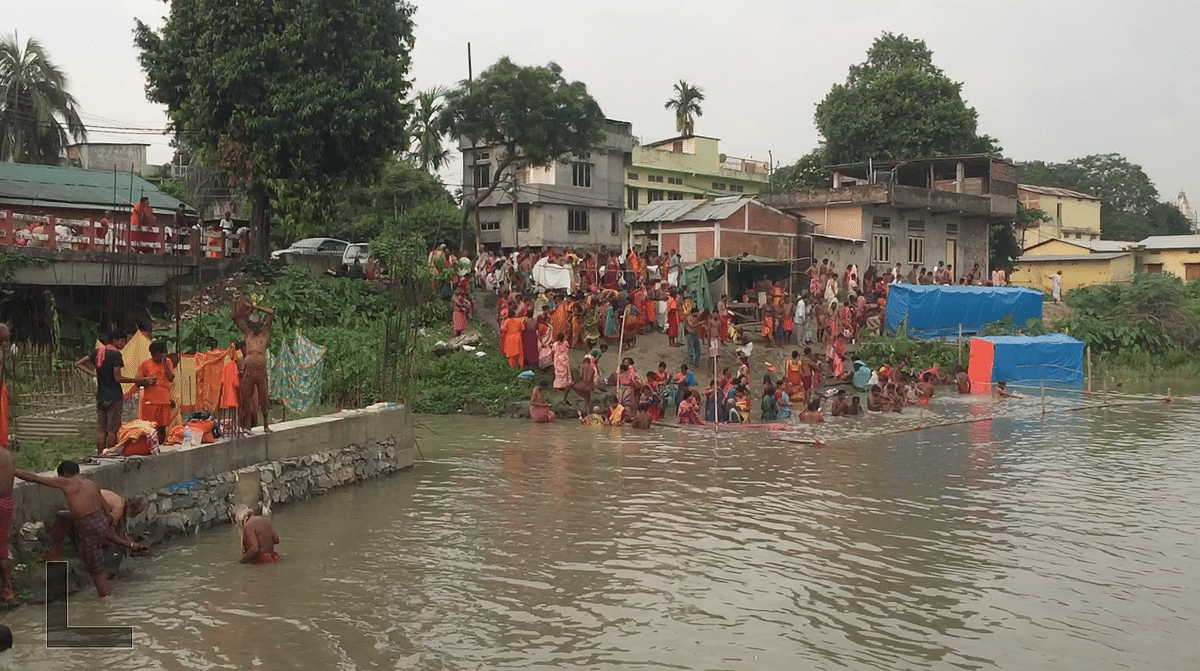 Pilgrims taking bath in the Brahmaputra river in absence of NDRF or SDRF personnel