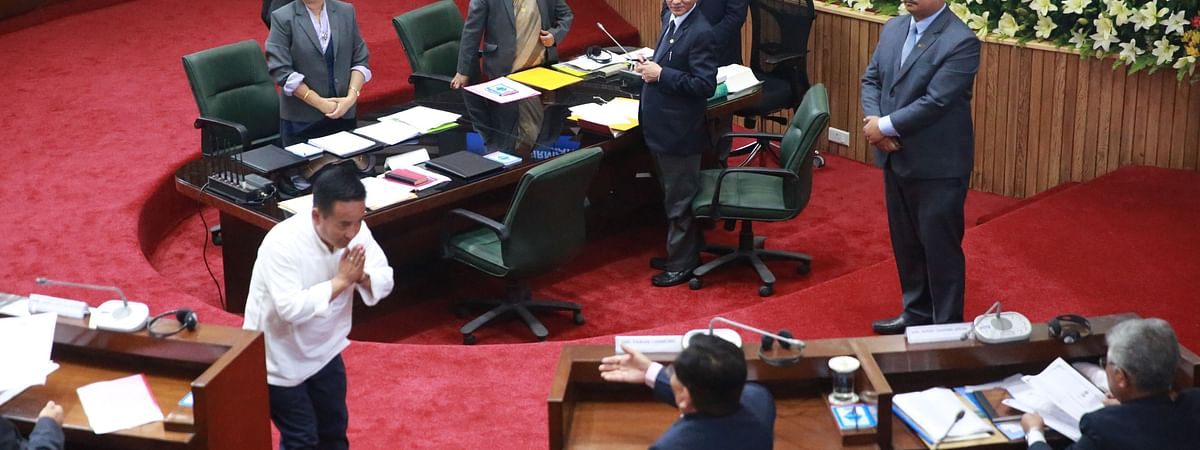 Sikkim's new chief minister PS Golay shares greetings with his predecessor and leader of Opposition Pawan Kumar Chamling on the floor of the state assembly