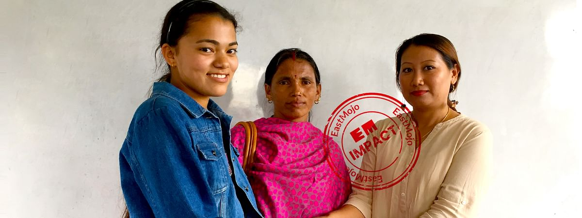 Momita Karki (left) with her mother (middle) and class teacher