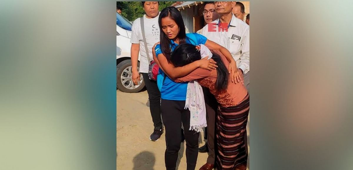 Indian hockey player from Mizoram Lalremsiami hugs her mother after reaching home in Kolasib district on June 25