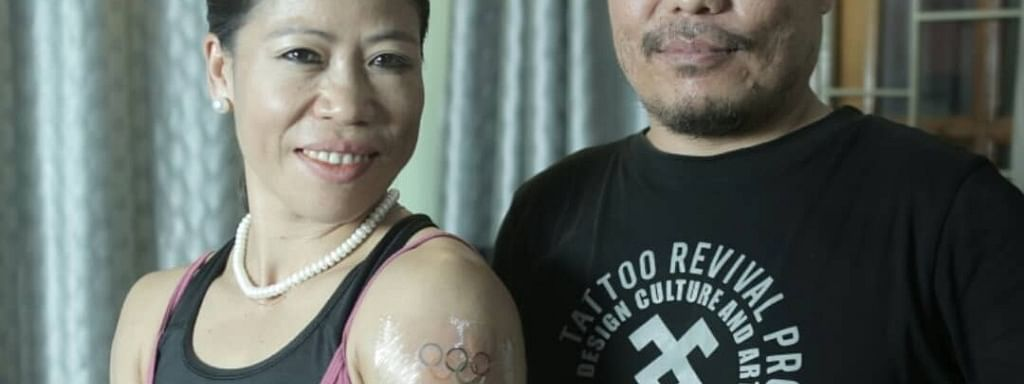 Indian boxer from Manipur MC Mary Kom (left) showing off her tattoo of the Olympic rings in New Delhi on Sunday