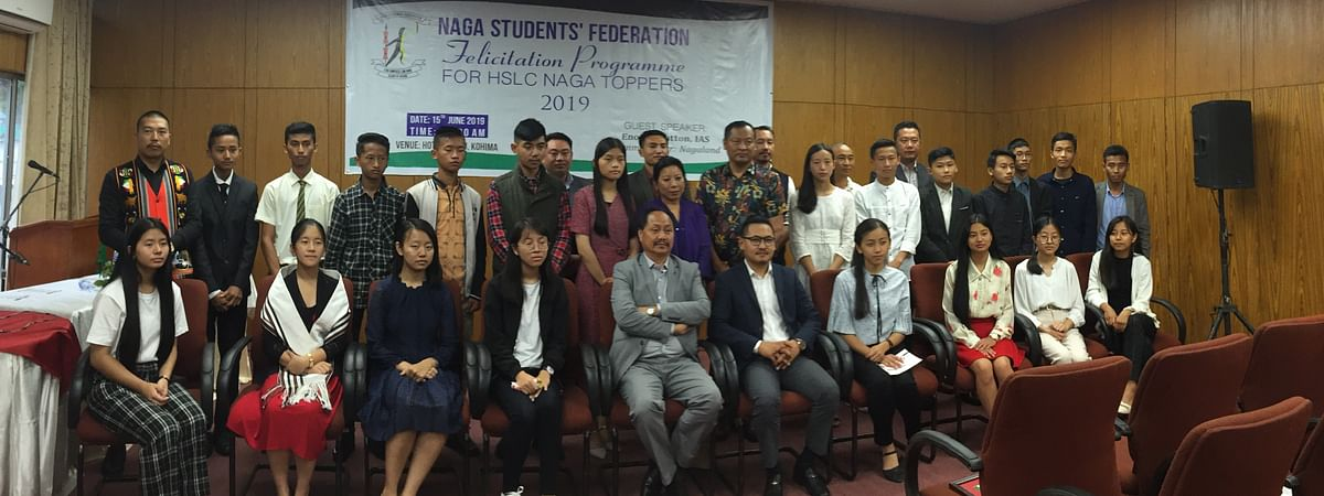Nagaland commissioner M Patton with the Naga Class X board exam toppers and Naga Students' Federation officials