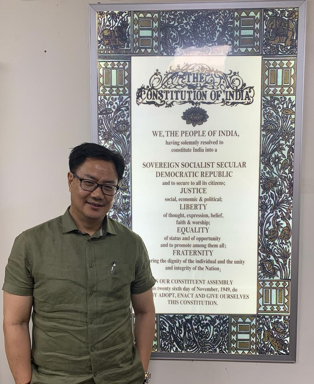 Union minister of state for youth affairs and sports Kiren Rijiju with a huge wall hanging depicting the Preamble to the Constitution of India at his home-office in New Delhi
