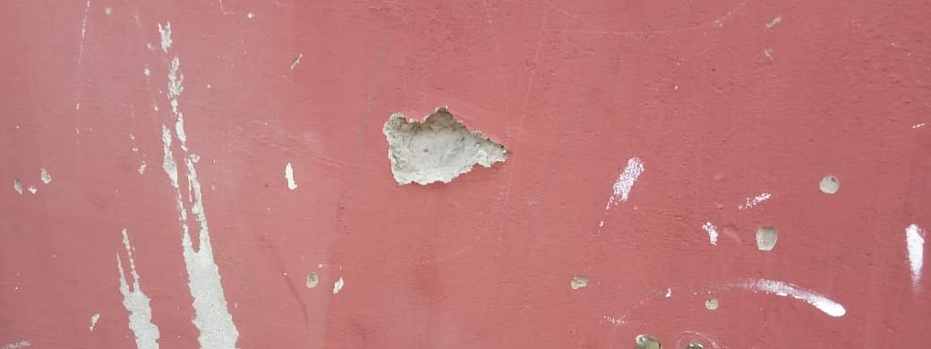 Bullet-ridden wall of Abu Metha's residence.