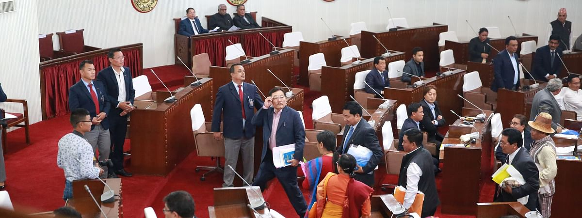 Former Sikkim CM Pawan Kumar Chamling staging a walkout after slogans were raised against him from the public lobby of the legislative assembly on Monday