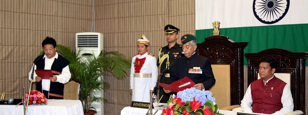 Phosum Khimhun (left) being sworn in as the pro-tem Speaker of Arunachal Pradesh legislative assembly on Sunday