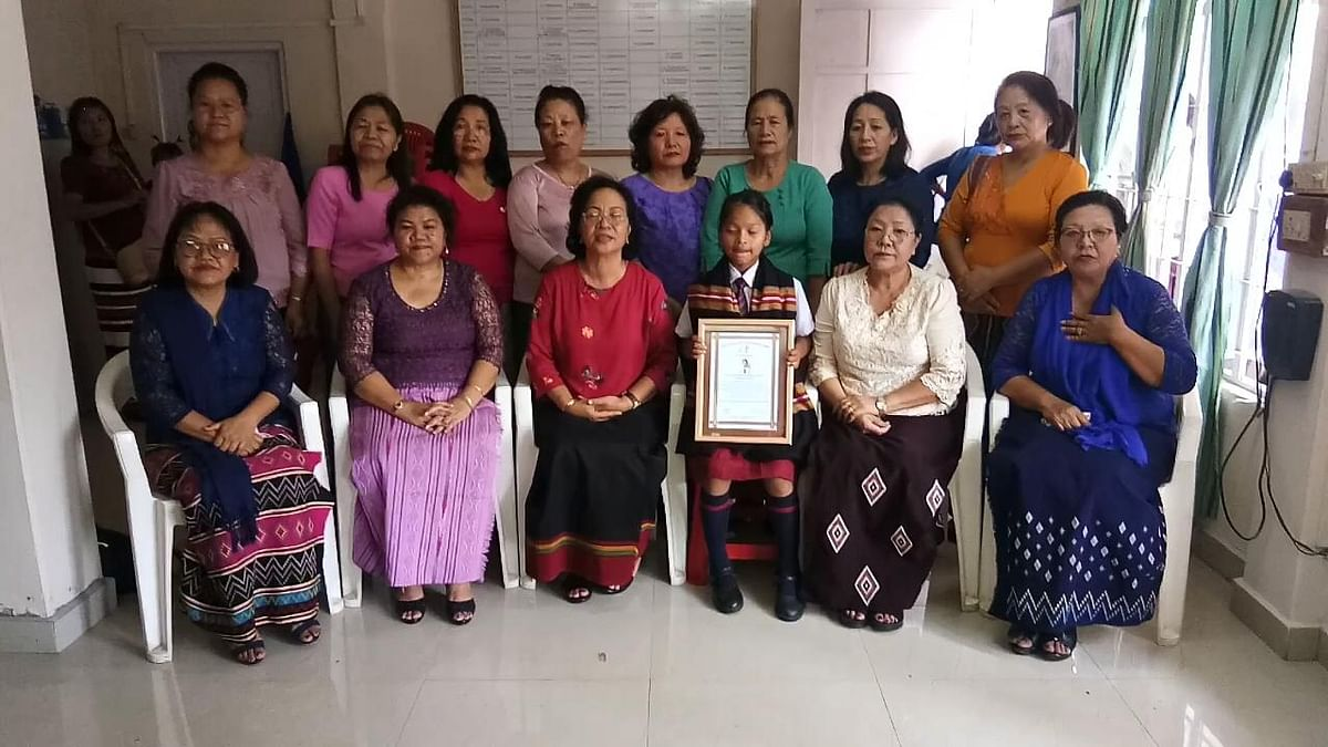 Caroline Malsawmtluangi with members of Mizo Hmeichhe Insuihkhawm Pawl, the lone women's body of Mizoram, on Monday