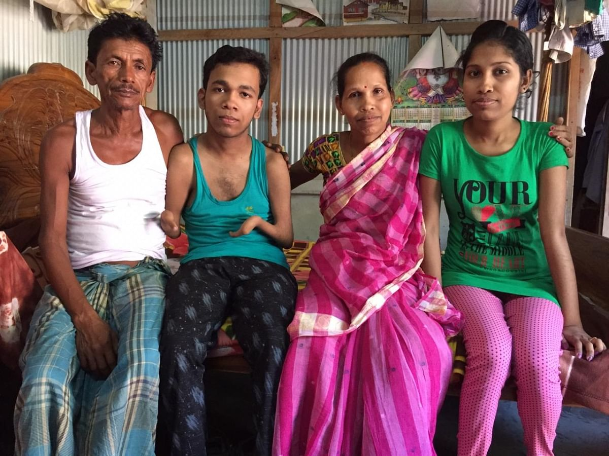 Pralay Dey (second from left) with his parents and elder sister