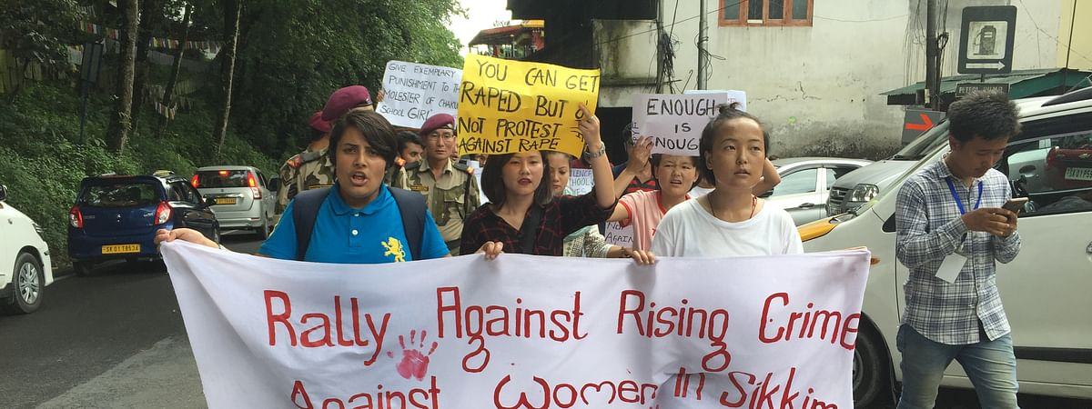 SPYF members holding placards protested for women's safety and demanding the new government to come up with stringent laws to protect them in the state