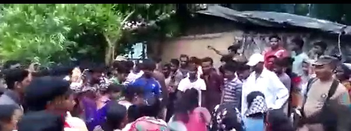 A video of the woman being thrashed by local residents in front of a police official has gone viral