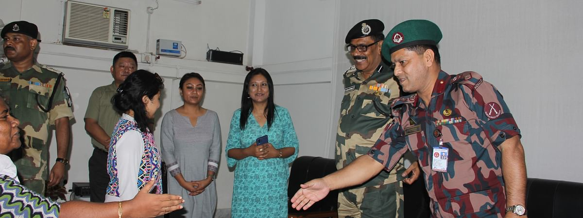 Border security forces of both India and Bangladesh along with members of Impulse NGO Network during the repatriation process of the six trafficked survivors on Sunday