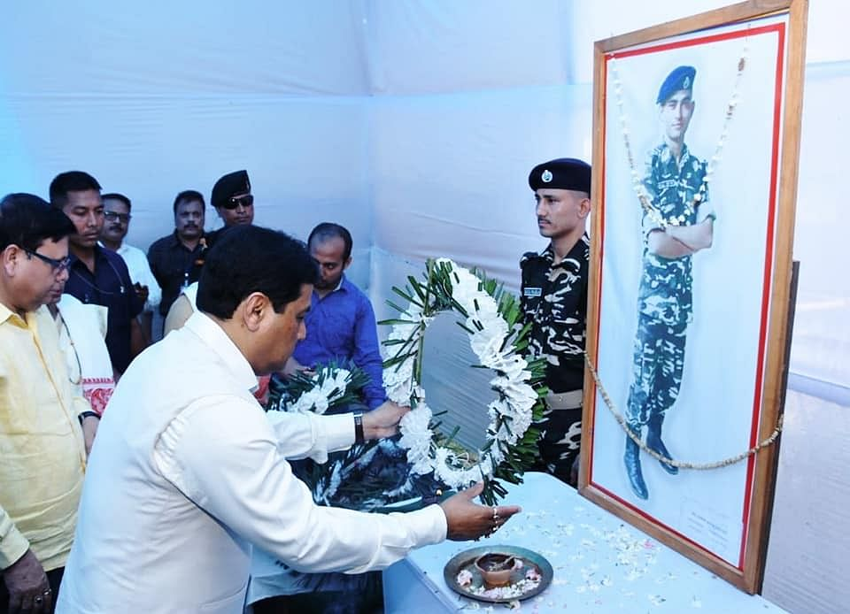 Chief minister Sarbananda Sonowal paying floral tributes to martyr Niraj Chetry at Halem on Thursday