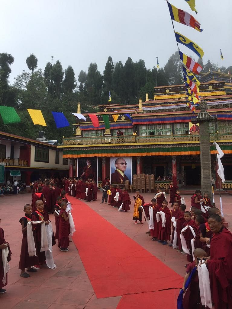 Monks lined up to offer prayers