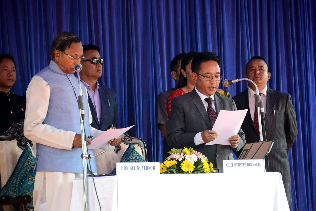 SKM president PS Golay being sworn in as the new chief minister of Sikkim by state governor Ganga Prasad