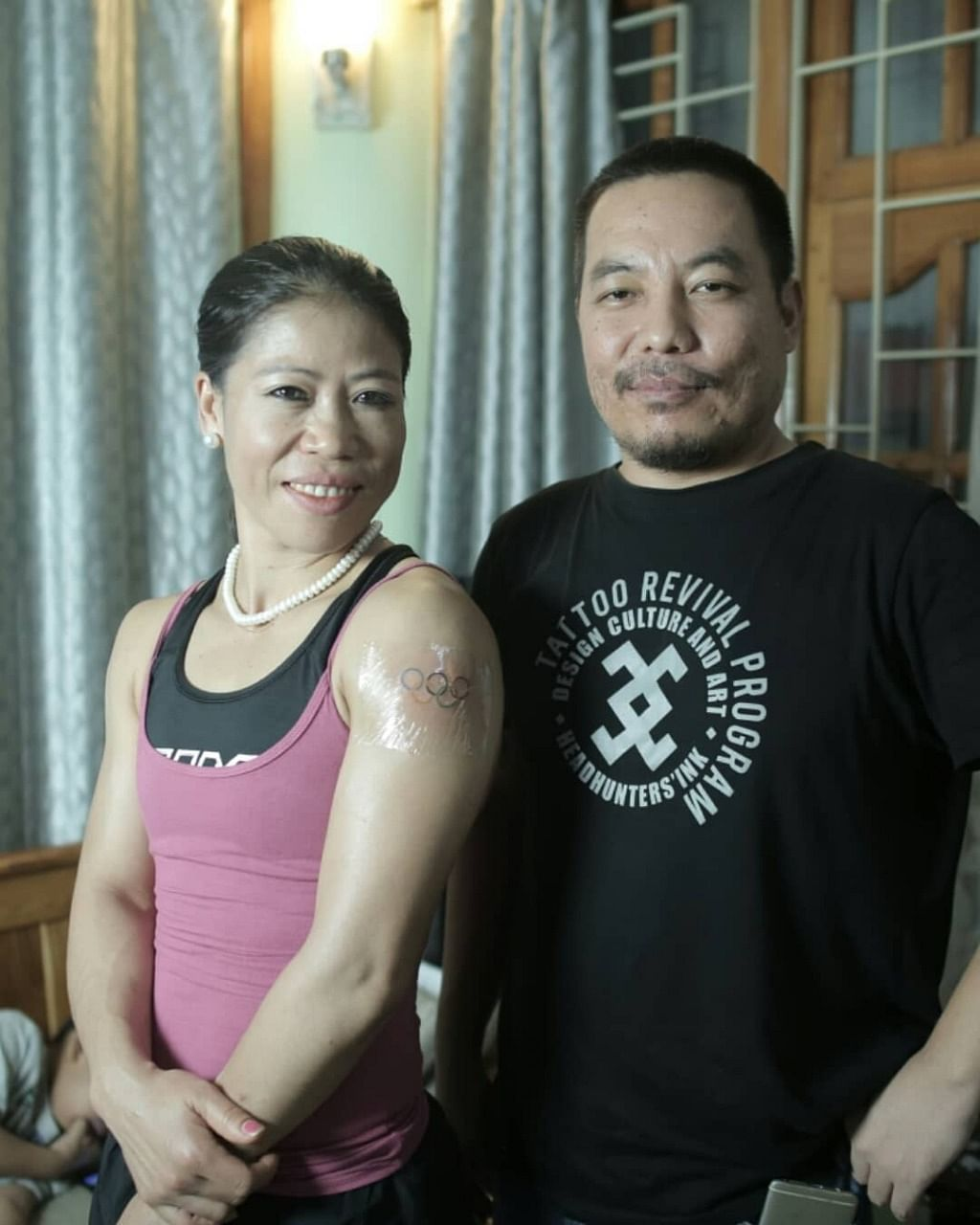 Indian boxer from Manipur MC Mary Kom (left) with tattoo artist Mo Naga in New Delhi on Sunday
