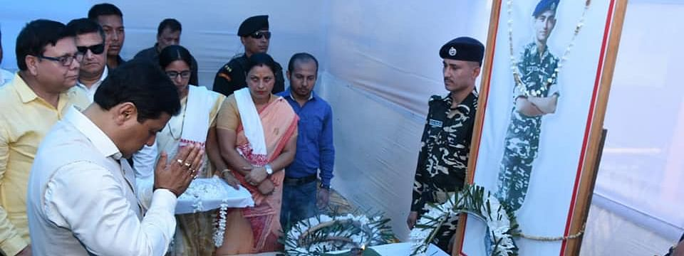 Chief minister Sarbananda Sonowal paying tributes to martyr Niraj Chetry at Halem in Assam's Biswanath district on Thursday