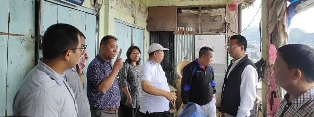 Mizoram commerce minister Dr R Lalthangliana along with tourism minister Robert Romawia Royte inspecting the proposed site for a new market building