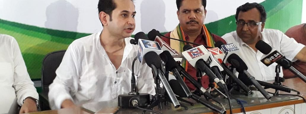 Tripura Congress president Pradyot Kishore Manikya DebBarman (left) addressing media persons in Agartala on Thursday