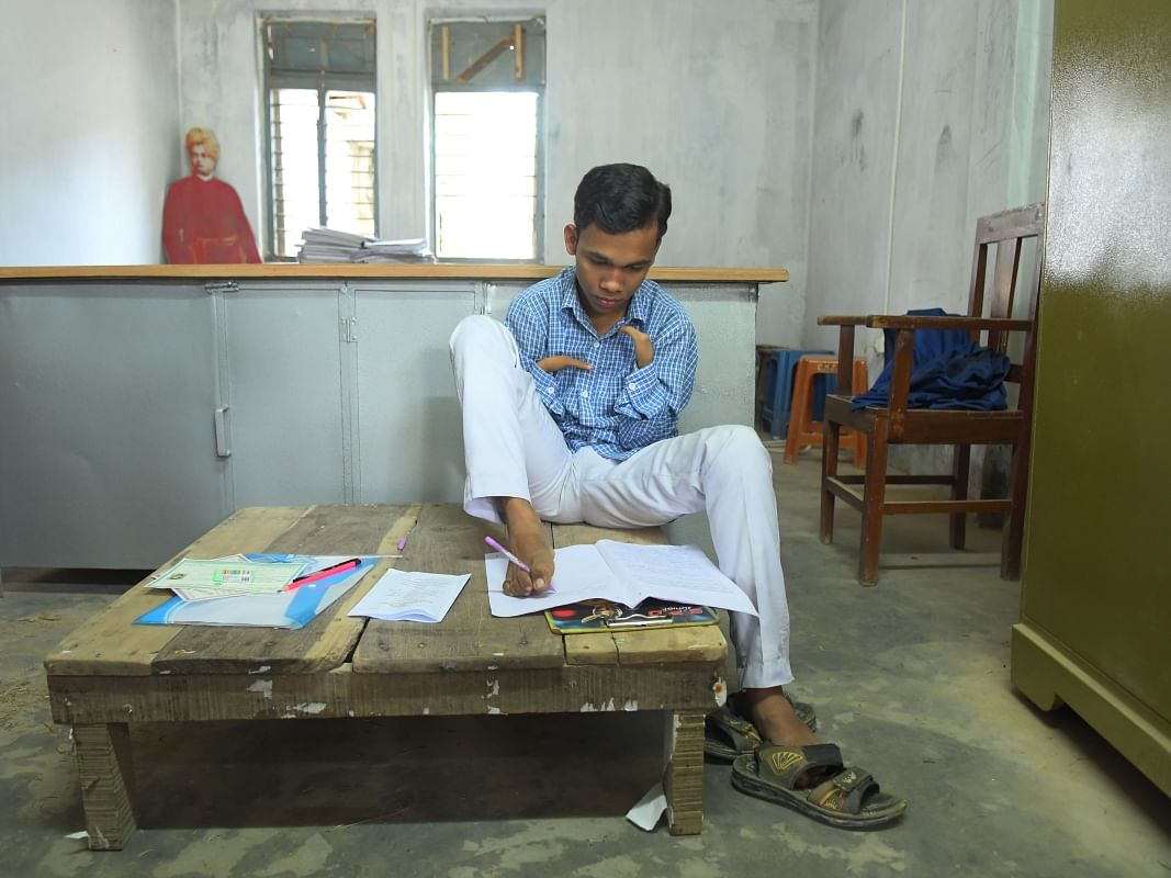 Class X board exams: Using feet, Tripura boy scripts success story