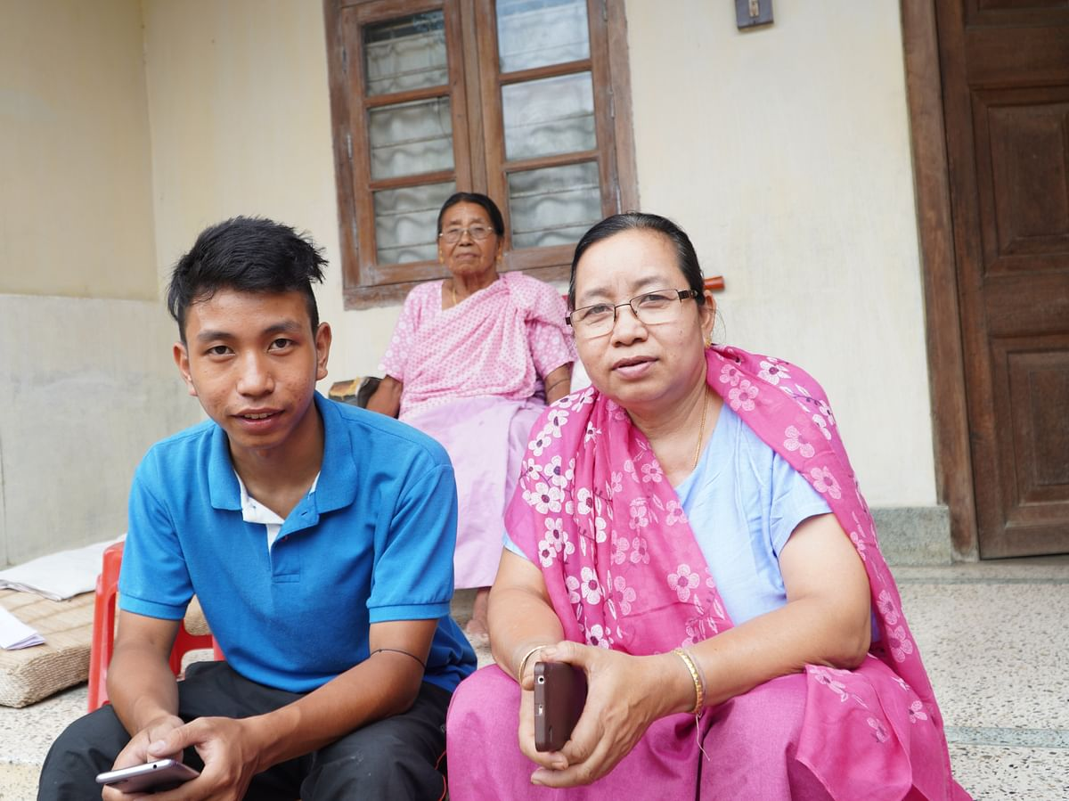 Zonel Sougaijam (left) with his mother ArambamTilotama Devi (right) and his grandmother in Imphal, Manipur