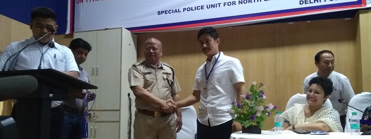 Joint commissioner of police David Lalrinsangha awarding special police ID to community leader Mavio Woba
